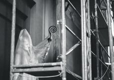 Sculpture of John Paul II pope behind protective foil in church stock photo