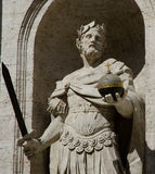 Sculpture of king holding the sword and the cruciger Stock Photos