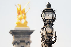 Sculpture and lamppost Stock Images