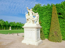 Sculpture of Laocoon on main alley in Gardens of Versailles. Marble replica of the famous sculpture `Laocoon and His Sons` on the King`s alley in the Gardens of Stock Photography