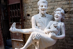 Sculpture of the laughing couple Stock Images
