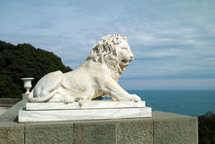 Sculpture of a lion. Against the sea Royalty Free Stock Photography