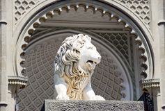 Sculpture of a lion. In an arch aperture at an input in a palace royalty free stock photography