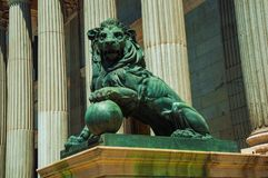 Sculpture lion cast in bronze on building facade in Madrid. Sculpture of imposing lion cast in bronze on the front facade of Palacio de las Cortes in Madrid stock images