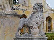 A sculpture of a lion in the garden. One of the sculpures in the park of the villa Barbaro at Maser in the Veneto region of northern Italy stock photography