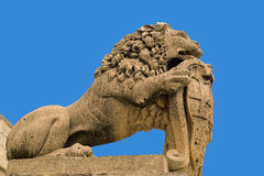 Medieval sculpture of lion, isolated on blue Stock Images