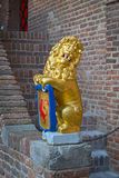 Sculpture : a lion holding shield with coat of arms Stock Image
