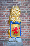 Sculpture : a lion holding shield with coat of arms Royalty Free Stock Images