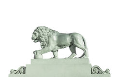 Sculpture of a lion Isolated on white background. Sculpture of a lion made in 1832 on the embankment of the Neva River in St. Petersburg, Russia, Isolated on Royalty Free Stock Photo