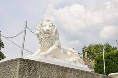 Sculpture of a lion of marble at the entrance to the Vorontsov Palace. Crimea. Fortress wall and the tower of the Vorontsov Palace. Crimea. Alupka royalty free stock photography
