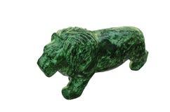 Semiprecious stone malachite. Sculpture of a lion from a precious stone malachite royalty free stock photos