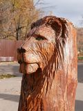 Wooden sculpture. The lion`s head. royalty free stock photo
