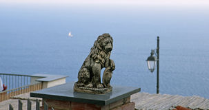 Sculpture of a lion and the sea Stock Images