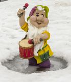 Sculpture of a little gnome with a drum stock photography