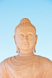 Sculpture of the lord buddha. Smiling with blue sky in Thailand Stock Image