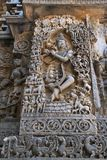 Sculpture of lord Krishna as Muralidhar playing flute , west side wall, Hoysaleshwara temple, Halebidu, Karnataka. Sculpture of lord Krishna as Muralidhar royalty free stock photos