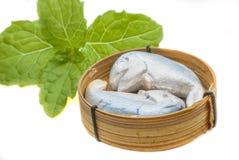 Sculpture mackerel fish in bamboo basket Royalty Free Stock Photo
