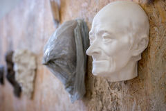 Sculpture of the male face of the elderly. Horizontal frame. Sculpture of the male face of the elderly Royalty Free Stock Photos