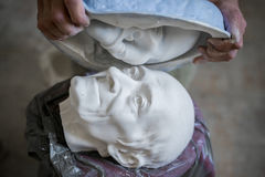 Sculpture of the male face of the elderly. Horizontal frame. Sculpture of the male face of the elderly Stock Photo