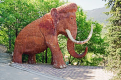 Sculpture of a mammoth in Yalta zoo Stock Image