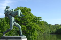 Sculpture of a man bears a woman. In the Vigeland park, Oslo Stock Photography