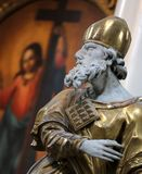 Sculpture of a man in a Catholic priest`s cassock. Stock Photos
