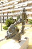 Sculpture of Man on dolphin Stock Images