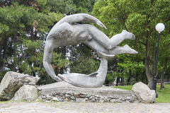 Sculpture of man with dolphin Royalty Free Stock Images