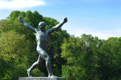 Sculpture of a man with his hands up. In the Vigeland park, Oslo Royalty Free Stock Images