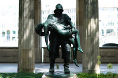Sculpture of a man holding a woman / fisher saving near drown gi stock images