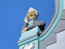Sculpture of a man looking through lorgnette in Tallinn, Estonia Royalty Free Stock Image