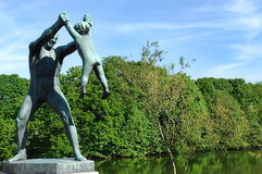 Sculpture of a man playing with a child. In the Vigeland park, Oslo Stock Photos