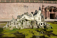 A sculpture of a man on rocks in marble near the castle of Heide Stock Photo
