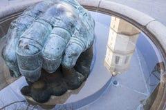 Sculpture Mano de pelotari by Manolo Boix and tower el fadri ref. Lection water,Castellon,Spain Royalty Free Stock Images