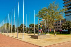 Sculpture Marc in Barcelona. BARCELONA, SPAIN - APRIL 10, 2017: Sculpture Marc in front of the 169 flag posts of the nations that sent athletes to the 1992 Stock Photos