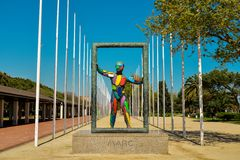 Sculpture Marc in Barcelona. BARCELONA, SPAIN - APRIL 10, 2017: Sculpture Marc in front of the 169 flag posts of the nations that sent athletes to the 1992 Stock Images
