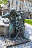 Statue in Dusseldorf, bronze monument blacksmith with boy Royalty Free Stock Photography