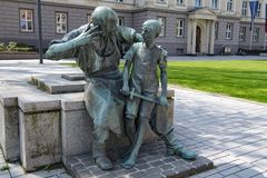 Statue in Dusseldorf, bronze monument blacksmith with boy Royalty Free Stock Photo