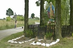 Sculpture of Mary. Wayside shrine with a sculpture of Mary, mother of Jesus Royalty Free Stock Photography