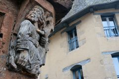 Wooden sculpture on a medieval house in Brittany, France stock photos