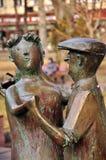 Sculpture, men and women Stock Images