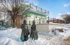 Sculpture of a merchant-man with merchant-woman. Sculpture of a merchant-man with a merchant-woman near a cafe in Dmitrov on a sunny winter day Royalty Free Stock Photo