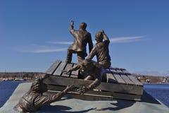 Sculpture merchant mariner. Sculpture merchant mariner in ocean facing blue sky stock images