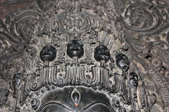Sculpture with micro carved hallow skull at Hoysaleswara Temple Royalty Free Stock Photo