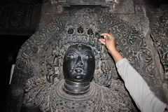 Sculpture with micro carved hallow skull at Hoysaleswara Temple Stock Images