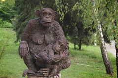Sculpture. A monkey with a cub. royalty free stock photography
