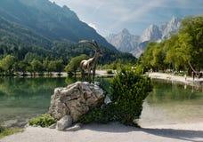 Sculpture of mountain goat - symbol of Julian Alps near artificial lake north of Krajnska Gora Royalty Free Stock Photography