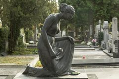 Sculpture of the mourning woman at the graveyard Royalty Free Stock Photo