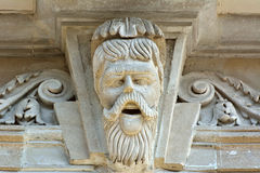 Sculpture of moustached man on facade of architectural building in downtown Baku. Baku, Azerbaijan - July 23, 2017.  Sculpture of moustached man on facade of Stock Photography