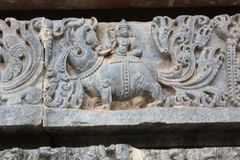 Sculpture of the mythical beast Makara on the outer wall of Hoysaleshvara Temple. Halebidu, Karnataka, India which was built in 12th century by hoysala empire Royalty Free Stock Images